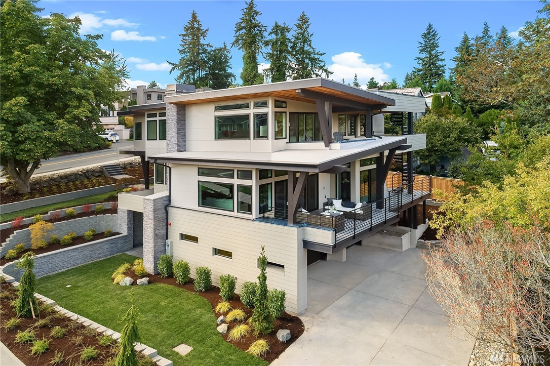 Stunning Custom Contemporary built with exquisite detail & superior modern features. Great room opens to Chef's kitchen w/oversized Quartz Island. Multiple covered decks for PNW living. Lavish master suite w/5-piece spa bath & makeup vanity area. Floating staircases, Quartz countertops & Huntwood cabinetry throughout, high-end appliances & rooftop deck. Rec Room w/Kitchenette, Flex Rm & 3/4 bath on lower. Astute design, Wi-Fi control feat, Dual Furnaces 2 A/C's, 3-car garage.  Ideal location!
