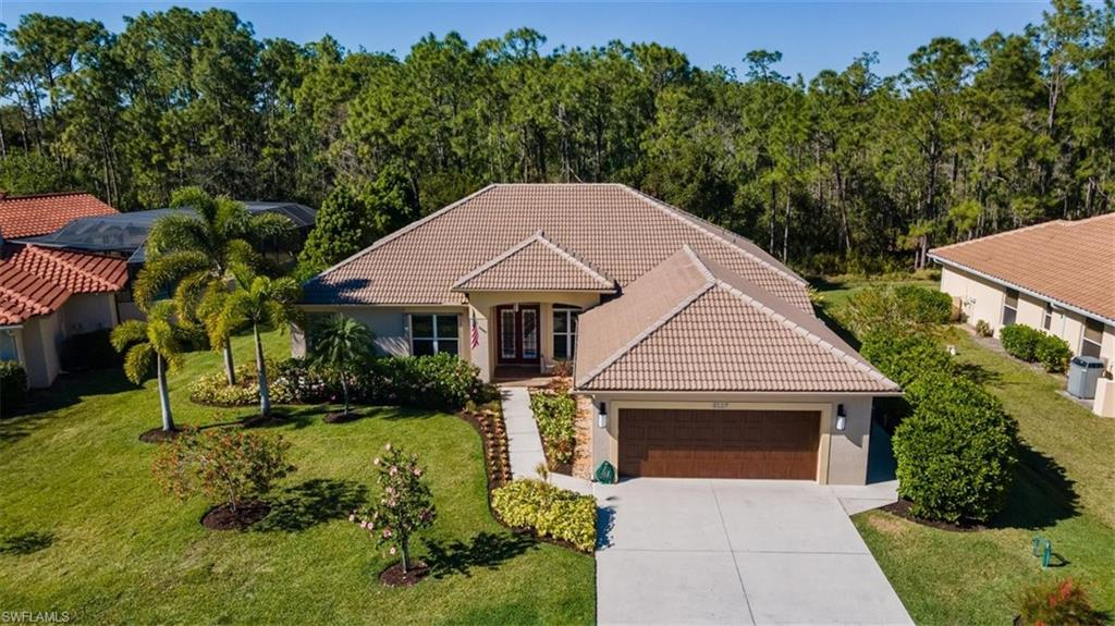 Completely updated great room floor plan with beautiful wood flooring throughout the living area.  Soaring ceilings, walls of glass make this an exceptional offering.  The gourmet kitchen with large island is open to the great room.  The dining room is strategically located off the other side of the kitchen and open to the great room.  Easy access to the covered lanai and beautiful granite, SS appliances make this kitchen a cooks delight.  There is a den with a closet off the great room perfect for an office/workout room or bedroom.  The master suite has 2 walk-in closets, and a spa like bath.  Two more guest bedrooms share another updated bath.  A powder bath is perfect for dinner guests.  The sparkling pool views the large preserve and makes this very private and quiet.  The garage is oversized with extra store closets.  Walking distance to the newly renovated community center with pool and tennis.  A great value in a great location!