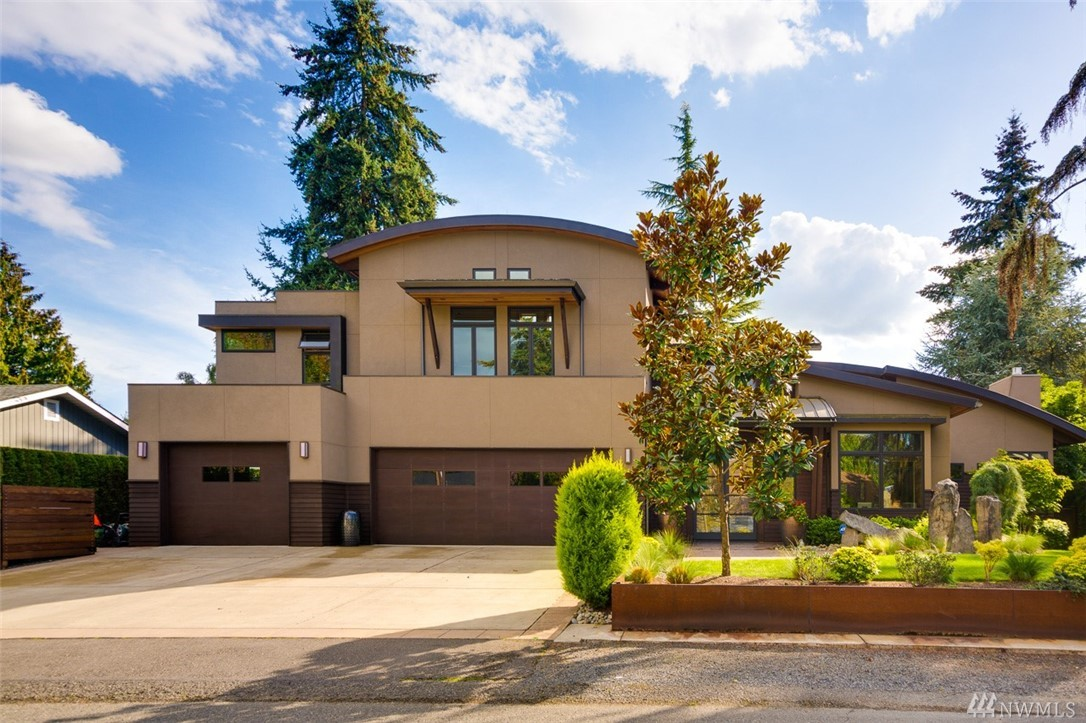 Contemporary Masterpiece!  Stunning architectural lines of this custom Adam Leland Home unfolds before you.  Built with finest in construction quality & design.  Some of the exquisite finishes: metal radius roof, 8x12 exposed beams, cedar soffits, 5'' braz cherry fl & spiral staircase.  Gourmet kitchen incl 2-sub zeros, Miele espresso machine, Dacor and Makore custom cabinetry in kitchen & huge Basalt slab island; great for entertaining! Coveted Bellevue schools & just blocks from Freeways & DT!