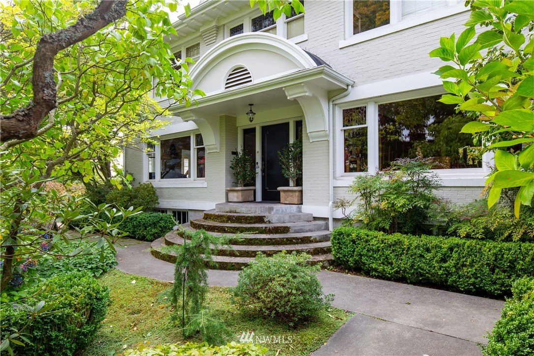 This classic home located on an iconic corner of QA enjoys fabulous protected views of Downtown, Elliot Bay & Mt Rainier. The home has been tastefully renovated to combine its quality finishes with todays' living. Gracious formal rooms w stunning leaded windows, beautiful trims and hrwd floors all lending a warm/inviting feel to the generous spaces. Updated kitchen w eating area has marble counters, gas cooking. Step out to separate studio/office space and 2-car garage The 2nd level has 3 bedrooms incl primary suite w sitting room and spectacular views. 3rd floor office/flex spaces. The garden area includes charming spaces to enjoy the mature landscaping & patios. Lower level provides complete additional living spaces