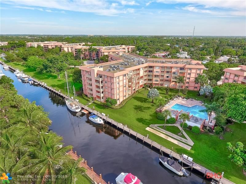 Fort Lauderdale's Best kept secret!Seller Will contribute to closing cost with an acceptable offer. Purchase with low money down, this is a financially secure building in Highly sought after River Reach Waterfront Condo Community offering a lifestyle Boating,Tennis Courts, Fitness room, Kayaking, 3 heated pools & outdoor Grills to entertain. This is a corner unit a true 2 bedrm/ 2 bath. New laminate wood flooring throughout, New water heater, Brand New Samsung over sized front load washer & dryer, New AC.  There is no leasing for first 2 years. In summary, this is a great place to live, meticulously maintained & should not be missed on your journey to find a perfect condo!!