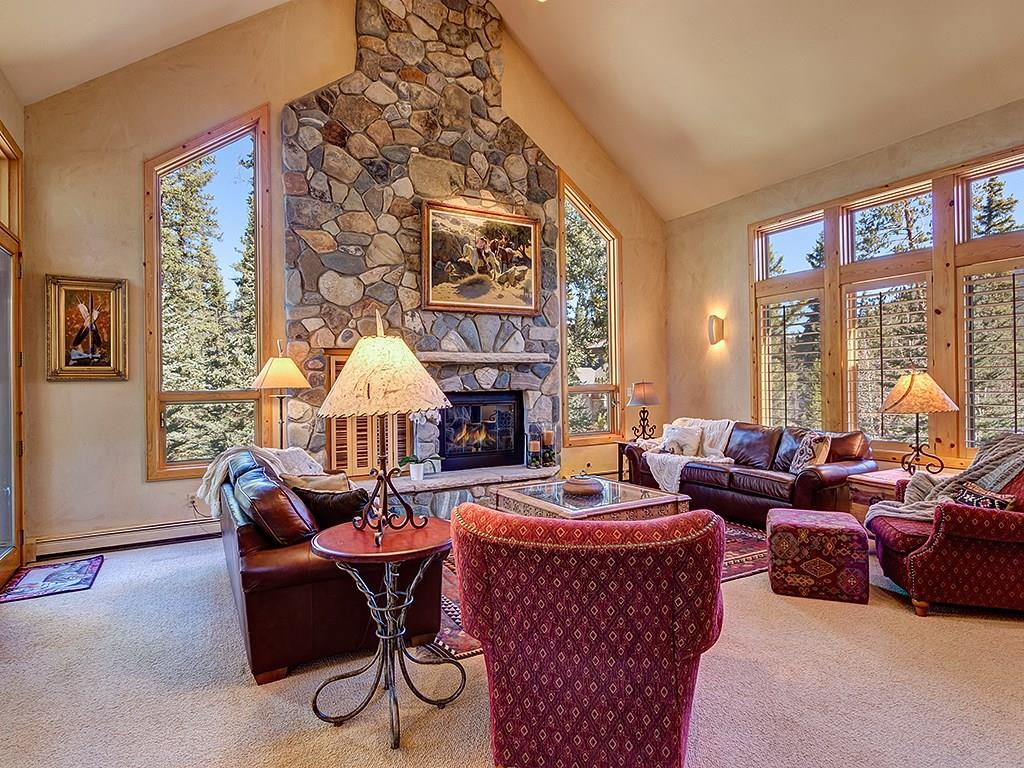 Come home and enjoy the Great room with Vaulted Ceilings,  substantial timbers and a stone fireplace.
