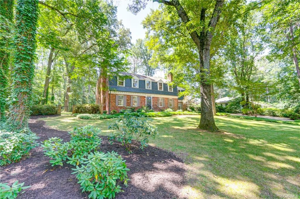 Welcome home to this lovely and charming brick and slate colonial with a picture-perfect setting. Gracious formal rooms that are light and bright, wonderfully large family room with brick fireplace and custom built-ins located off of the spacious eat-in kitchen with granite countertops and stainless Monogram and Sub Zero appliances. The sun-filled kitchen is the very heart of this home and opens to a fabulous sunroom! Expansive mudroom with cubbies, built-ins, storage and even a coffee bar leads right to the large and beautiful back yard. Second level has 4 roomy bedrooms as well as an office, or playroom. The master suite has the potential to have a sitting room, currently is being used as another bedroom. Enjoy a warm summer day while relaxing on the brick patio admiring the elegant and private back yard. Hardwood floors throughout, mouldings and chair rail, much storage. Short drive to Trinity School, Va. Power Boat Association, shopping and dining.