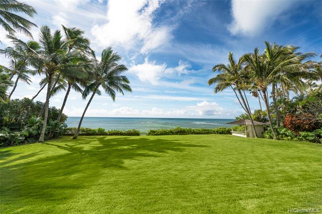 A Location Unlike any Other…Prepare to step back in time & experience this fabulous Diamond Head beachfront estate situated on over 36,000 sf of land w/expansive rolling lawns & beautiful tropical landscape w/mature fruit & flowering trees. A timeless residence graciously rests on this legendary parcel overlooking 123 linear ft of prime sandy beach frontage & mesmerizing ocean vistas. A lovely open floorplan offers striking hardwood floors, open beam board & batten ceilings w/combed redwood walls & large, picturesque windows throughout. Sliding glass doors connect to spacious wrap around seaside lanai's ideal for sunning by day or dining at sunset while overlooking azure waters & rolling waves. Multiple lounge areas throughout seamlessly connect the main living rm, adjacent family rm & large office/flex rm all w/exceptional views. A spacious kitchen w/wrap around counters overlooks coastal landscapes & has a pass-through counter uniting the oceanside covered lanai w/counter seating. A peaceful Master Suite offers vaulted ceilings, dual baths + adjacent lounge area w/private balcony. This rare & truly sought-after location is magical & offers a once in a lifetime opportunity.