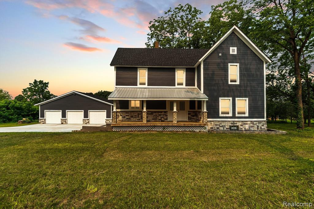 Gorgeous completely remodeled farmhouse on 1 acre in Hartland schools. Close to US 23, minutes from Howell & Brighton. Everything is new from top to bottom! New HVAC, ROOF, WINDOWS, SEPTIC TANK AND FIELD, PLUMBING, ELECTRICAL, FLOORING, PAINT AND LIGHTING! Stunning open kitchen is out of this world! Quartz counters, custom soft close cabinets, SS appliances. Electric vented fireplace in the living room. New deck and 3 car detached garage. All new cement with extra parking.   A/C to be hooked up Monday 7/26/21 All permits finalized by closing There are still finishing touches. Buyer will be allowed walk through touch up list.