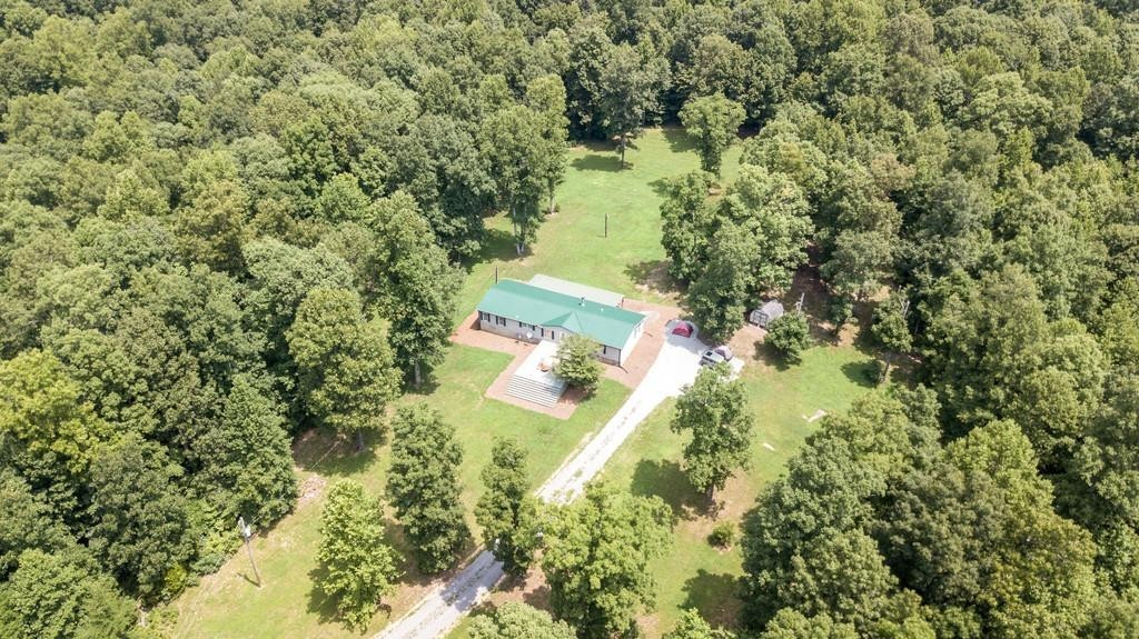 10 acres in the heart of Leipers Fork!  Beautiful land is private, top of hill terrain w/ existing 3BR/2BA manufactured home - 2 additional build sites (refer to septic map attached).Property is prime-already set up as a mini-farm, ideal for an individual looking to build dream home(s), or an investor looking for short-term /long-term rental opportunity!7' privacy fence surrounding the 10 acres w/ a gated entrance. Property is within 2 miles of Downtown Leipers Fork, Natchez Trace Pkwy + more!