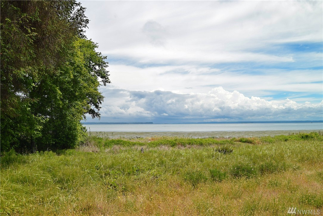 Beautiful Bayfront lot with ultimate privacy and seclusion featuring 217 feet of waterfront frontage. This lot is considered by some the best Bayfront lot in town. Property has already been cleared and driveway installed so it is ready for camping and building. This land also has water, sewer, and power ready to hook up and located in the street. Walk to the beach and enjoy the local parks, pools, and boat launches. Seller financing available with 30% down and $1000 per month.