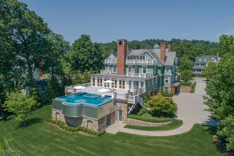 This extraordinary home in Morristown's downtown historic district blends the bones of a stately 1901 mansion with the sophistication & style of a 21st-century estate.  A gut renovation & expansion transformed the residence with no detail overlooked; the finest craftsmanship and materials. Contemporary living at its best with 10ft ceilings, a wine cellar, elevator, half-size indoor basketball court, and 3-sided infinity pool with spa overlooking the lush 2-acre property. Bright open spaces, high ceilings, and 12 fireplaces give the iconic home a chic Manhattan feel. Arty touches include a sleek chef's kitchen and eye-catching four-story custom lighting fixture. A vibrant art and dining scene and, midtown direct train service make Morristown a lively and sought-after mid-sized town.