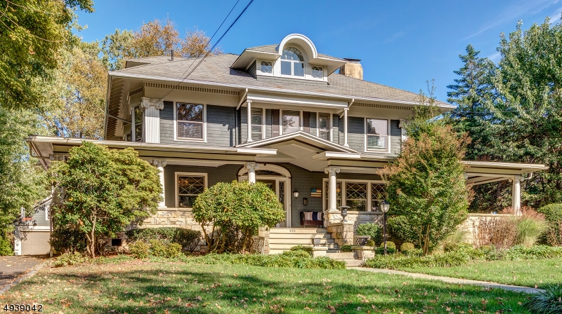 LOCATION!!! This gorgeous colonial is walking distance to downtown, transportation & schools. This 5 BR home features a large foyer, 9' ceilings, hardwood floors, original chestnut woodwork, pocket doors, stained glass windows, two gas fireplaces & window seats in both the family room & second floor foyer which overlook the private backyard.  The updated kitchen includes top of the line appliances, honed granite counters, a center island, radiant heated floors and a staircase to the second floor.  The second floor includes 3 bedrooms and an office. The master suite is a true oasis featuring exposed brick, a large steam shower,and a soaking tub.
