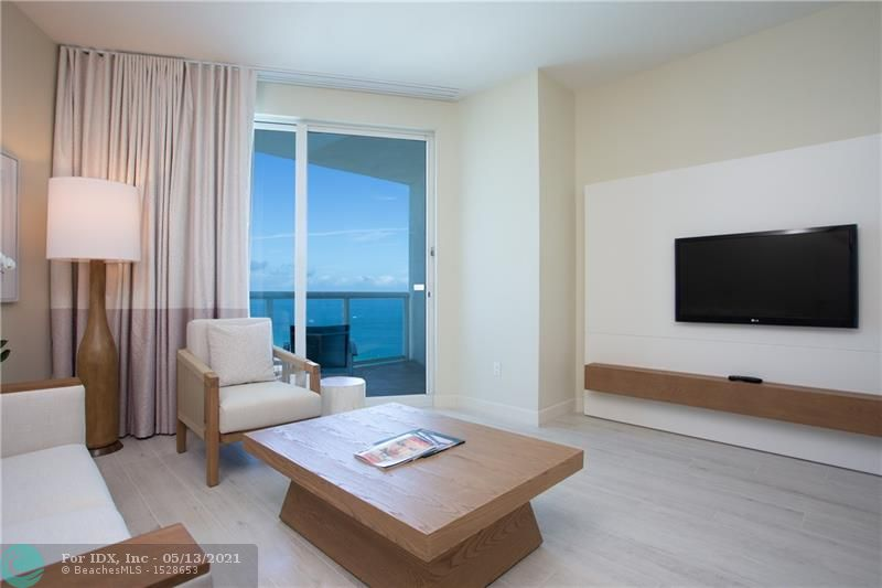Beach-inspired colors, open floorplan, and clean lines – welcome to the new look at 505 N Fort Lauderdale Beach Blvd. Unit 2406, one of the first to enjoy this transformation sits high enough above the surrounding landscape to continuously showcase the much-treasured ocean view. Floor-to-ceiling impact windows frame the view while keeping the unit bathed in light. The fully-furnished 1 Bedroom 1.5 Bath condo-hotel unit features a king bed, sleeper sofa, full kitchen, extra owner's closet, washer/dryer, and more. Resort-style service, hotel amenities including restaurants, bars, concierge, 24-Hour fitness center, spa, tropical pool deck, room service, business center. Optional Rental program managed by Hilton.