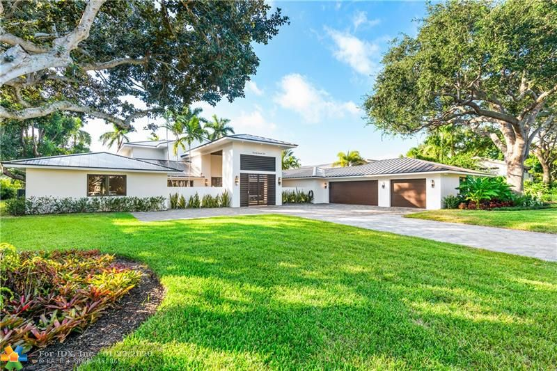 One of a kind estate located directly on the 9th hole at Coral Ridge Country Club.