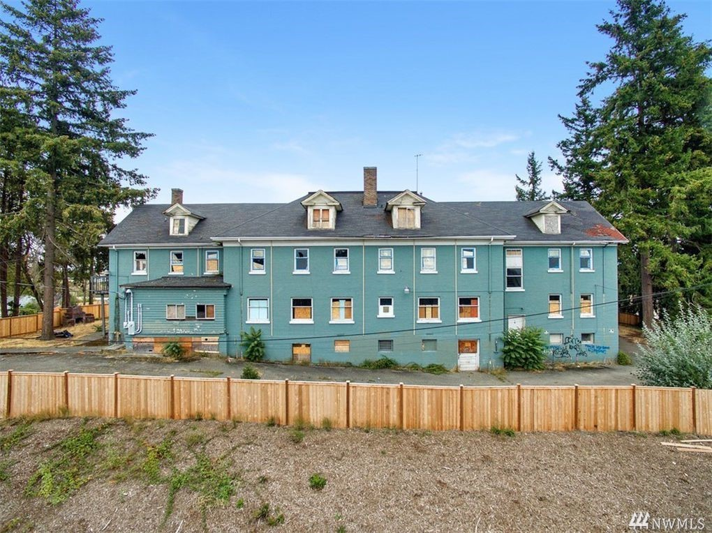 Investor Alert! 50 Bedrooms 11 Baths, 2 Kitchens.Large op upstairs. 24,000 sq. st 3 levels & basement.Large lot 3/4 acre.Permitted uses included church,daycare,school,building now which allows for Assisted Living,Group Housing,Medical Offices. Recent appraisal for $2.5 Mil Building is being Sold As Is.