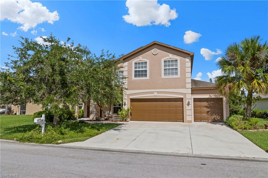 Lakefront Home nestled in the quiet community of Cypress Cay in Gateway! This spacious Two-Story, freshly painted exterior Home, offers a great open floor plan with almost 3,000 sq. ft. of living space.  The 4 large Bedrooms, 2.5 Baths, Main Floor Office and 2nd Story Laundry Room, make this home perfect for a growing family.  You will love owning one of the largest lots in the community, offering expansive Lake views that can be enjoyed while relaxing on your undercover screened Lanai and there is plenty of room to add your own custom pool. Storage is made easy with expansive closets throughout and a 3rd Car Garage which offers a separated project area.  Cypress Cay features great amenities including a Community Pool, Playground Area and well-maintained Common Grounds which are all included as part of the low HOA fee under $100 per month.  This Home is located in walking/biking distance to Schools, Parks, Restaurants and Services, in addition to being close to I-75, RSW Airport and Gulf Beaches.