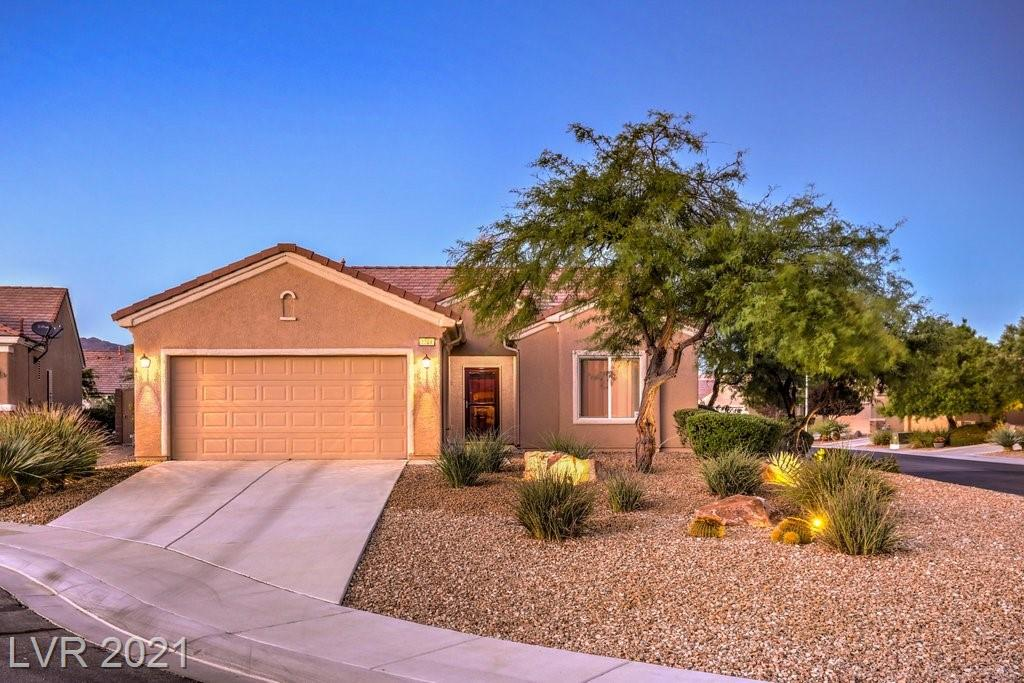 Gorgeous Single Story Home in Sun City Aliante, w/all of the amenities that you need. Kitchen has Viking appliances, less than a year old new dishwasher Kitchen Aid, Quartz Counters, upgraded back splash/walnut finish cabinets. Island w/SS farm/sink & plenty of room @ the breakfast bar. The Primary Bedroom is large & has access to the beautiful back yard, w/full size pool & separate semi-in ground spa. Outdoor Shower. Full covered patio with fans/lights/BBQ stub/sun shades. Upgraded ceiling fans/finishes, blinds and so much more! 2021 New A/C installed, as well as Water Heater. Paid in full Pool Solar Heating. Fully sealed security door. Garage has cabinets & workbench. This Property will not disappoint.