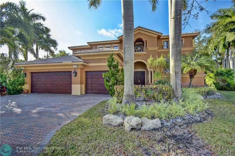 """Check off all of your must haves and """"Welcome Home"""" The home features 5 bedrooms, 5 full bathrooms, 3 car garage with an over sized bonus room possible 6th bedroom/playroom or entertainment.  2 A/C units, 12-28 ft ceilings which features Hunter Douglas customized electric blinds.  Master Bedroom located downstairs with 2 walk in closets that features custom California closets.Plantation shutters in master bedroom, large master bathroom.  The home also features a 2nd bedroom downstairs with a full bathroom. Large Open Kitchen. Step outside and enjoy the private landscaping, screened in pool with spa, over sized patio for all of your entertaining. Located in """"The Vistas"""" in Heron Bay, this beautiful home sits on a cul-de-sac lot ( A-RATED SCHOOLS)"""