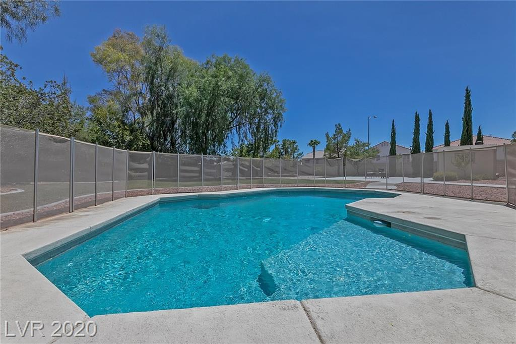 Welcome home! This rare 5 bedroom home has an oversized bonus room that is big enough to be used as a 6th bedroom. The sparkling pool and covered back patio on the half acre lot are perfect for hot Vegas summers! BK COURT APPROVAL REQUIRED