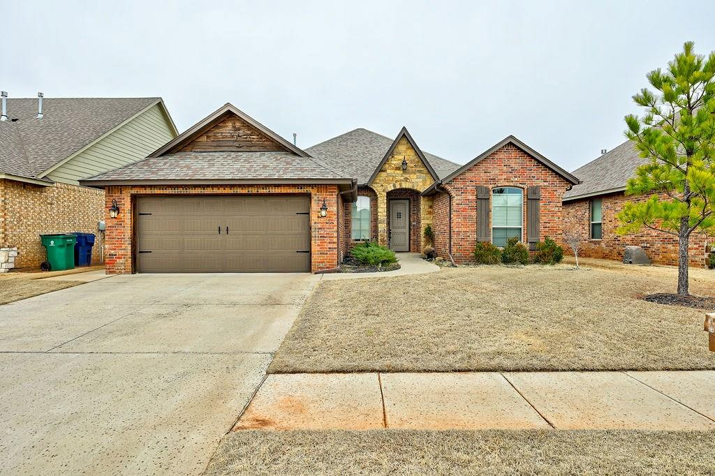 This impeccable 4 bedroom 2 bath home is like new construction without the headache or the cost! This move-in ready home in the sought after Savannah Estates neighborhood is not only in the Piedmont school district but also has a community pool! The fully fenced pet-friendly yard offers lots of privacy AND backs to the greenbelt!   High ceilings and arched doorways frame the inviting living room with its custom stone gas log fireplace and warm hardwood floors. The gourmet eat-in kitchen has stainless steel appliances, lots of granite countertop workspace, glass backsplash, an island, and a large pantry. The plush master suite has a jetted tub, custom tile shower and a huge master closet with walk through to laundry room/ mudroom. Lots of built-in storage, spacious guest rooms and closet space in this wonderful home. Enjoy the covered porch and perfectly maintained backyard, great for entertaining! Don't miss out on this perfect home, convenient to the turnpike, shops, and restaurants!
