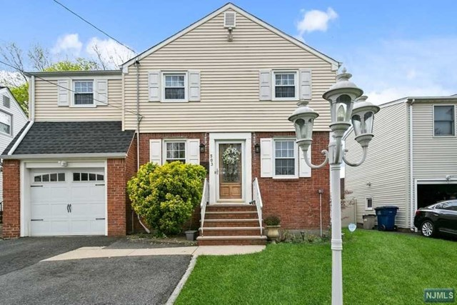 Quit location, Large side hall colonial with hardwood floors , fireplace, huge family room , updated kitchen with granite counters, full finished basement with laundry area, central air, vaulted ceilings .L shaped rear deck. attached garage.