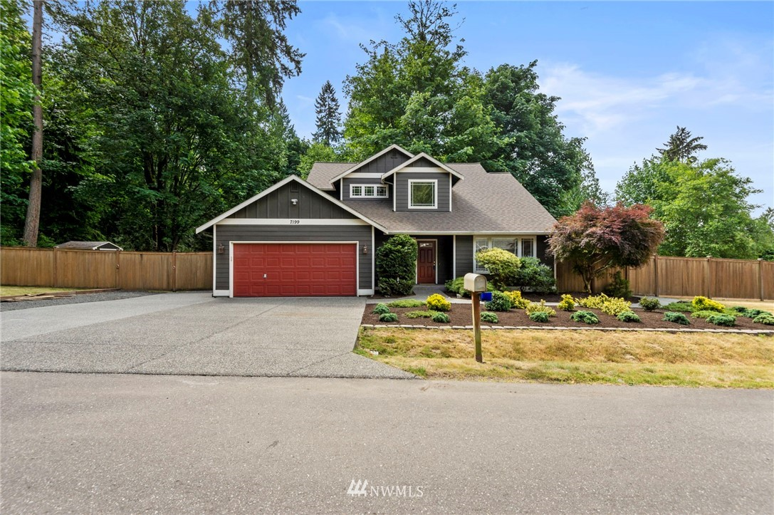 Picture perfect spacious home, nestled between Poulsbo & Kingston and sure to please. Lined by greenery is a fully fenced expansive yard, a patio that wraps the back of the home ideal for BBQ'ing this summer. Light & bright living spaces featuring vaulted ceilings in the living & dining room. Tastefully designed kitchen w/granite, SS appliances +pantry, overlooking breakfast nook & family room. 1/2 bath & laundry room in the hallway on the main. Up you'll find 4 bdrms, including a master suite encompassing vaulted ceilings, private bathw/walk in closet. 3 additional bedrooms + full bath. Oversized 2 car garage, ample parking, minutes to the community waterfront, shopping and ferry!