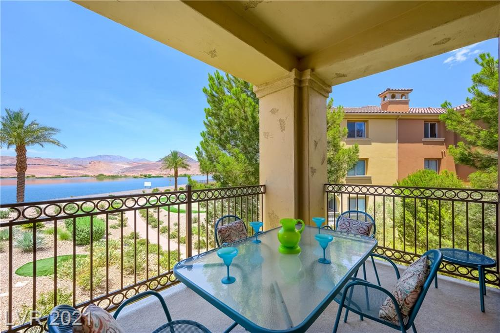 Amazing, unobstructed, lake and mountain views await you from this 3 bedroom condo in the pristine community of Mantova located within the guarded gates of SouthShore at Lake Las Vegas. The unit features high end stainless steel appliances, a bar with built in wine refrigerator, granite counter tops, kitchen island with breakfast bar seating, hardwood and stone flooring. The front courtyard overlooking the building atrium and the expansive view of the lake and mountains from the balcony provide additional, inviting, living and entertaining spaces.The unit is freshly painted and in move in ready condition. The complex has onsite management, outdoor pool, putting green, underground owner and outdoor visitor parking. Easy access to golf, water activities, hiking, biking, close to restaurants, hospitals, shopping and more. About 30mins from the strip.