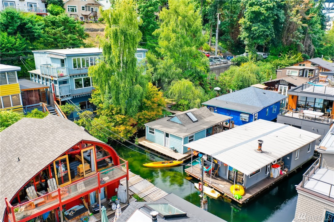 """Welcome aboard """"Sweet P"""", a cozy floating home with owned condo slip in a quiet oasis in Portage Bay. This is 2019's most affordable floating home listing. Space for small boats on 3 sides of the home. Walk-around deck. To the studs interior remodel in 2017.  Pets & rentals allowed. Reserved parking for 1 car. Gas available on dock. 15 min walk to UW. Community yard & friendly neighbors. Expand to 2 stories or make it a rental property. Buy a stake in waterfront property in the heart of Seattle!"""