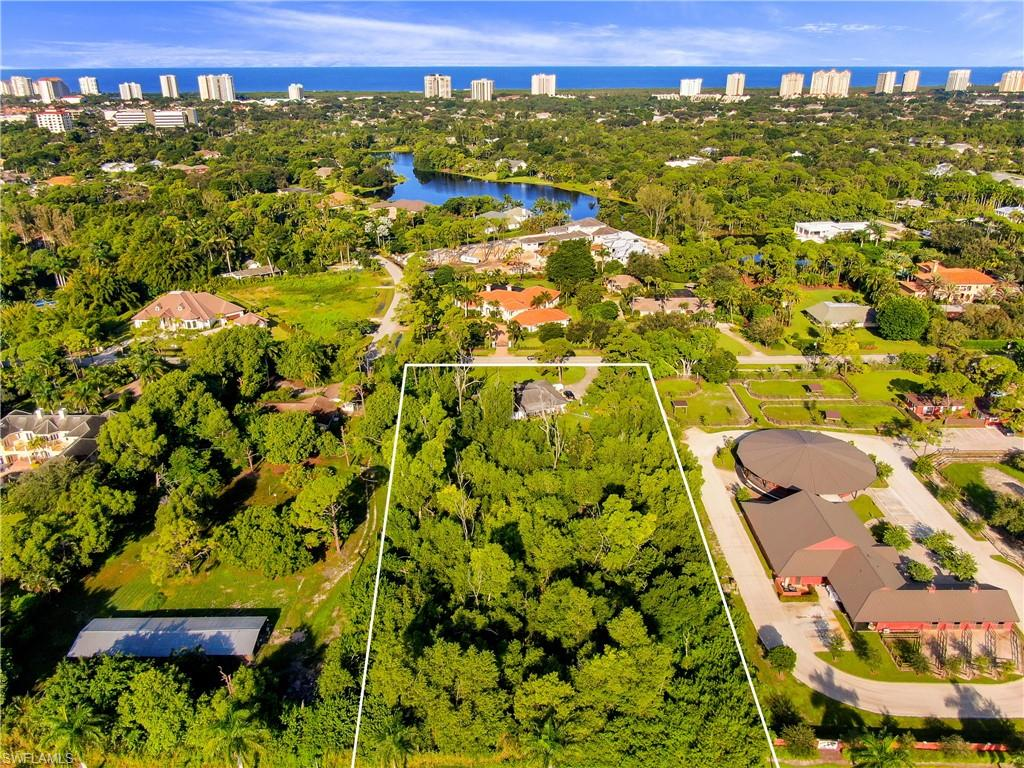 "Located among high value estates, this oversized 2.12 acre lot is a rare opportunity to build your dream home in the idyllic Pine Ridge Estates.  Located less than a mile from the beach, minutes from Waterside Shoppes and restaurants, and close to a variety of schooling options, it's no wonder this community has been selected as the ""Best Neighborhood"" in the United States.  This lot is also located in the X flood zone and is zoned to allow for horses.  While the existing structure has not been factored into the price, there are renters in place and can provide income as you plan your future home."