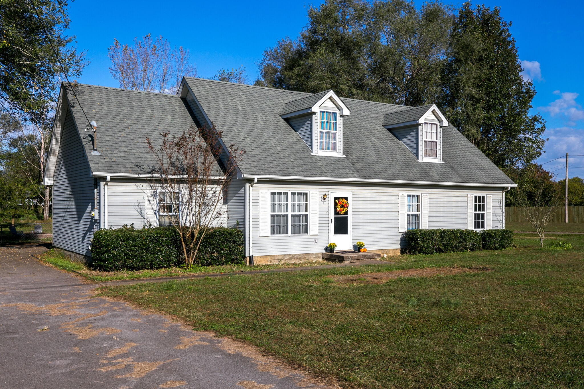 Rare Find!  Nearly an Acre - Flat, Treed Lot!!!  NO HOA.  3 Bedrooms 2 1/2 baths.  An ADDITIONAL TWO Large Bonus Rooms upstairs!  Custom Cabinetry in Kitchen, New Flooring, Appliances STAY (including Maytag W/D).  Double-Pane Windows.  Great schools!