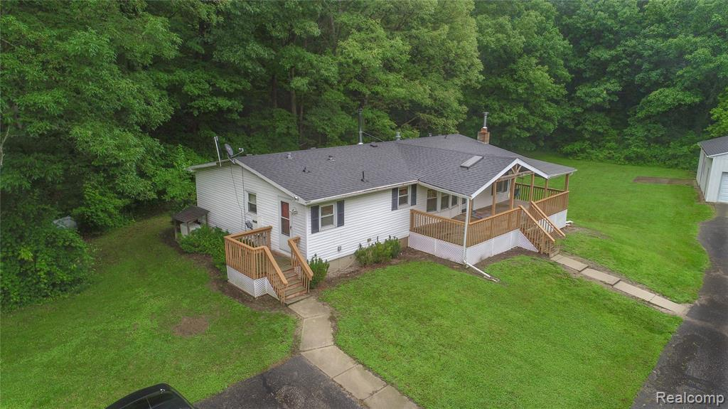 This open-concept ranch sits on nearly 11 acres with a HUGE pole barn and RV/car/boat port - an outdoor enthusiast's paradise! This home features a recently renovated kitchen that is fully equipped with top-notch stainless steel appliances, three bedrooms, and two full-size bathrooms (one of which is off the master). The sellers have spent hundreds of hours out on the spacious front porch and back deck - drinking coffee, reading, watching nature - you name it! The home has beautiful frontage, as it's tucked away against mature trees. The walkout basement is ready to be finished or used for storage. There is a whole house generator included. Newer roof, furnace, and central air. The well and septic inspections have taken place and are approved!