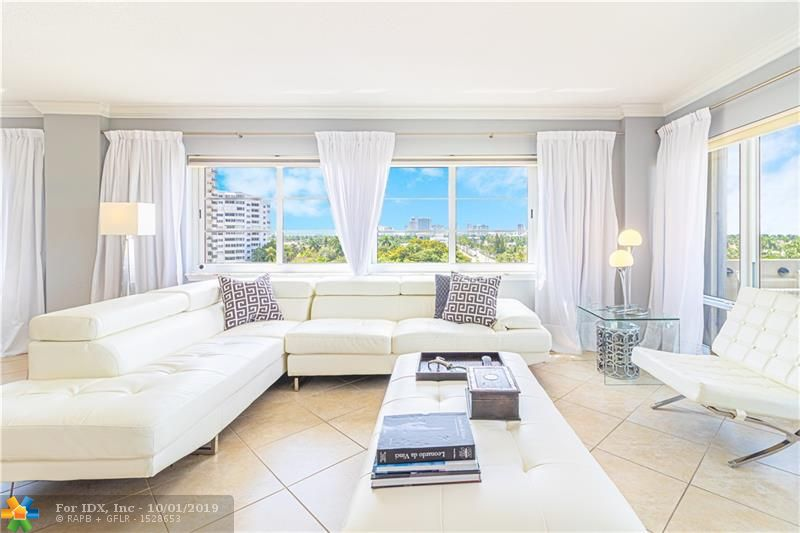 This beautifully upgraded 3 bedroom 2.5 bathroom corner unit with exposure to the North, East, and West, offers vast views of the downtown skyline all the way to the beach. Walls of windows surround the living spaces, bringing natural light and views to every room. The spacious and comfortable layout are perfect for entertaining with a flow through kitchen, dining and living area. Perfectly appointed with tile and wood floors throughout, modernized kitchen and baths, ample closet and storage space, custom fixtures and lighting.   Marine Tower is centrally located between downtown and the beach Right on Las Olas! Enjoy the many amenities the building offers including Fitness Center, Social Room, Library, and Pool.