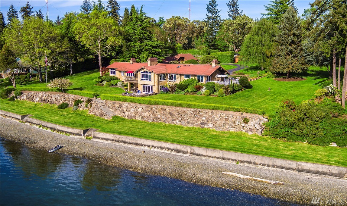 Harborside Retreat: Every inch of the custom home has been remodeled for full advantage of the remarkable panoramic views of Quartermaster Harbor plus a sweet guest studio. Enjoy northwest living at its finest, with nearly 3 acres of emerald lawns, spectacular 334' of  waterfront. True outdoor living with expansive decks & patios perfect for entertaining.  Some of the custom features:  stones, hardwoods, commercial style appliances, custom cabinetry & more.  Your wish list will be complete.