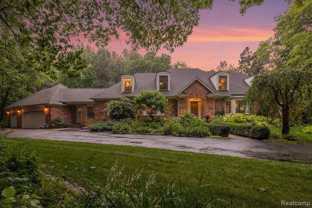 THIS SPECTACULAR HOME IS WRAPPED IN MORE THAN 3 ACRES OF FOREST AND LANDSCAPED WITH PLUSH WOODLAND PERENNIAL GARDENS. THE HOUSE HAS A FF MASTER W GAS FP AND REMODELED EN SUITE, HUGE FAMILY ROOM W GAS FP AND HISTORIC BARN BEAMS, LIBRARY, LARGE DINING ROOM.  THE COMPLETELY REMODELED KITCHEN W GRANITE COUNTERS, NEW QUALITY APPLIANCES AND CENTER ISLAND LEADS OUT TO THE SCREENED PORCH AND OPEN-AIR DECK W GORGEOUS VIEWS OF NATURE.  OVERSIZED FF LAUNDRY COMPLIMENTS THE CONVENIENTLY LOCATED MUD ROOM. THREE LARGE 2ND FLOOR BEDROOMS WITH ANGLED WALLS, CEILINGS AND DORMERS. THE LOWER LEVEL WALK OUT INCLUDES THEATER ROOM WITH HIGH-END HARMON KARDON AUDIO EQUIPMENT, SPACIOUS COZY FAMILY ROOM W GAS FP, HUGE BEDROOM AND ADJOINING BATH. THE THREE-TIERED REAR YARD DECK OVERLOOKS WOODS W COMPLETE PRIVACY. UPDATES INCLUDE NEW ROOF, WINDOWS, 3 FURNACES, 3 CENTRAL A/C UNITS, LIGHT FIXTURES, DRIVEWAY, WATER SOFTENERS/RO SYSTEM AND PORCHES. THE ONLY HOME AT THE END OF A CUL-DE-SAC ONLY MINUTES FROM I-96.