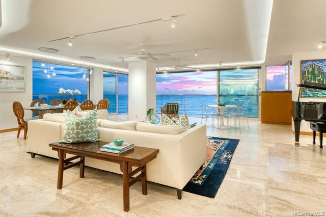 Stunning residence at the most sought-after building on the Gold Coast! Extraordinary, contemporary 2 Bd, 2 Bath + large den apartment at the ocean's edge offers expansive views of the Pacific, the Waikiki coastline, iconic Diamond Head & Kapiolani Park while offering great privacy and security.  Designed by architect John Black, it was completely rebuilt w/ exacting detail & quality.  The expansive space is ideal for everyday living or fabulous entertaining & is complete w/ a wonderful professional kitchen with expansive island & counter seating.  The study/workspace is perfect for a home office. Enjoy glorious sunsets and sailboats gliding by, or step out the door for swimming, surfing, biking or jogging.  World-class shopping, dining and entertainment are an easy walk into Waikiki.