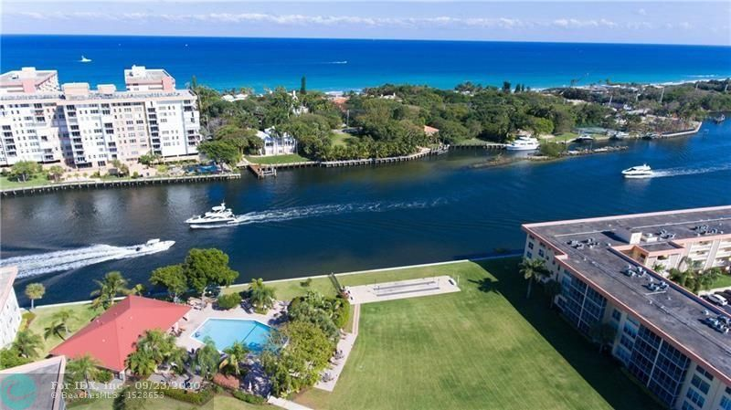 Enjoy views of the majestic Intracoastal Waterway and the entertaining parade of boats from this condo home that is conveniently located on the first floor. Walk out your backdoor to the water, heated pool, clubhouse or BBQ area. Recent updates include flooring, bathroom and impact glass. Maintenance fee included cable and Internet. Boat dockage is available on a first come, first served basis at $3 per foot.