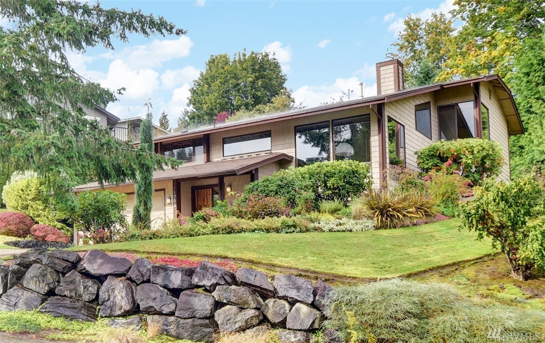 Stylish NW contemporary located in a quiet Rose Hill neighborhood. Close to Msft, Google and shopping. The home has been beautifully updated. Open and dramatic living area with high ceilings and an abundance of windows filling the home with natural light.  Kitchen features quartz counters and stainless appliances including a gas cooktop and double oven with trivection. Gleaming hardwood floors throughout. The decks and backyard are private and beautiful. Home is Cat 6 wired.