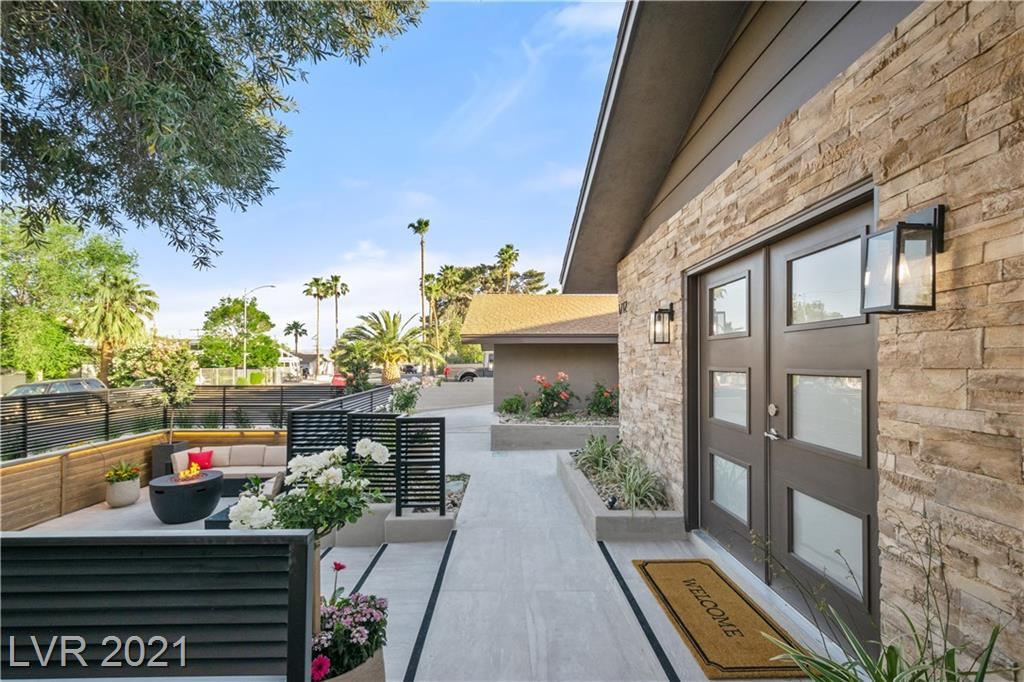 """Spectacularly Revitalized Arts District Home with Pool! This 2,792 sqft, 3BD, 3BA, 2 car garage home is practically new built. You can Staycation at home and entertain in your front & back patios! There are too many new features to list, but here are key highlights: all new doors and windows, new kitchen & SS appliances, 3 new bathrooms, 4 new sets of glass panel double-doors, new white oak wood-style tile flooring, 7"""" baseboards, tiled entry walkways, and new stacked-stone exterior.   Large pool with original diving board. The front courtyard is enclosed with vintage-style fencing and new landscaping with accent lighting. Oh so close to the Strip, Downtown LV and great eateries on Main Street."""