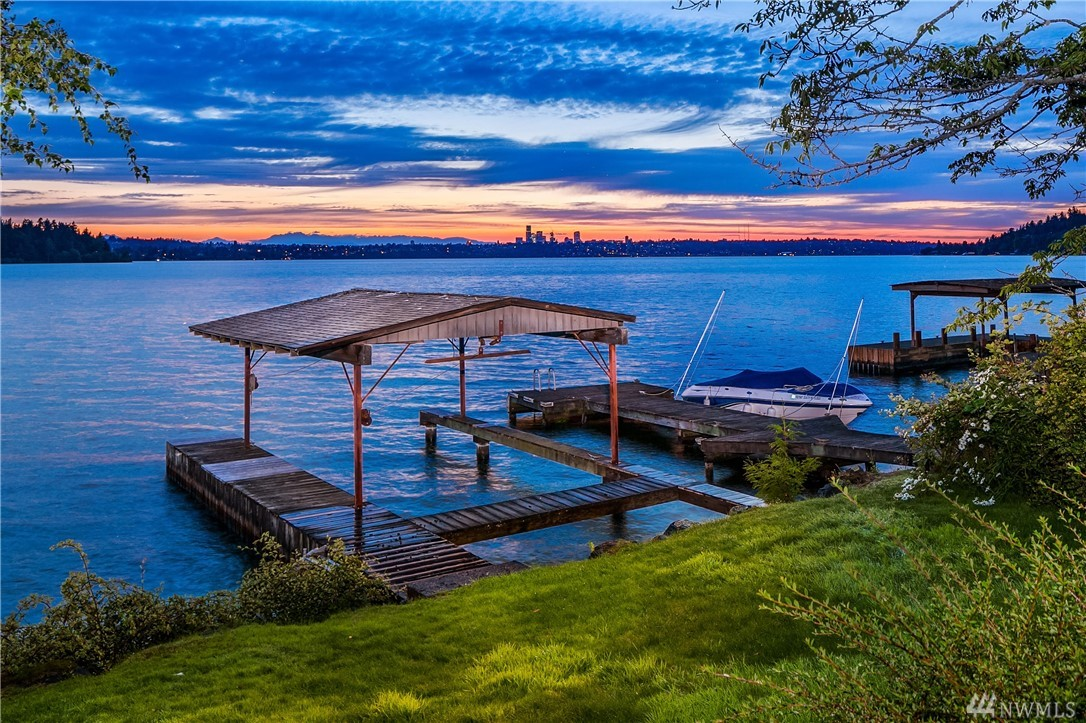 Your patience has been rewarded! Westside, mid-island, waterfront lot (22,230 sq') w/panoramic views of Seward Park, the Olympic Mtns & topped off w/the Seattle skyline. Enjoy this prime location featuring 60' of waterfront w/covered dock. Build your dream home or put your personal imprint on the existing 3,229 sq' 3BR home w/great rm living, main lvl master & lower lvl rec rm. It's a vacation to be home on popular Forest Ave where nature entertains without effort & sunsets speak for themselves.