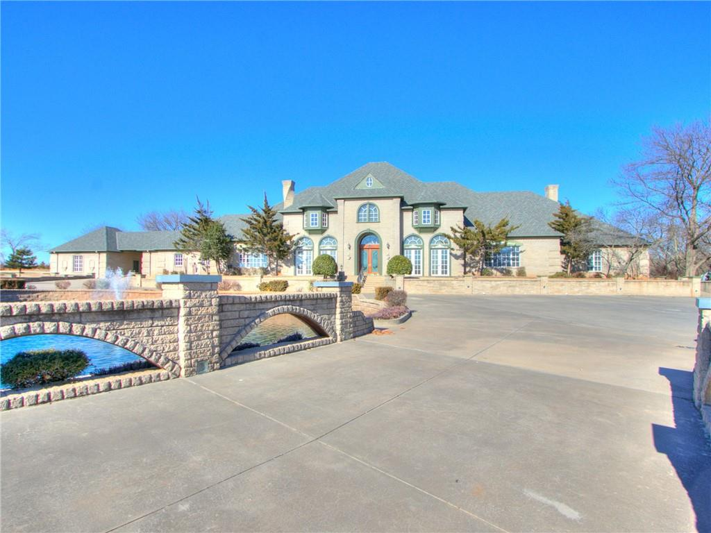This estate is absolutely breath taking. Too many features to list here. Property sits on prime location in Moore, OK. This house rests on a slightly wooded 6.5 acres and boasts over seven thousand square feet. Entry way is stunning and lit up by a gorgeous crystal chandelier.  Enjoy a movie in the theater room, have a drink with friends at the bar attached to the second living area, or enjoy some quiet time inside tranquil Florida room. House has elegant professional office designed to help you run your business at home. Just outside of this home is a detached building with a kitchen and large deck area great for cookouts of all sizes. Central vac, generator, 2 private wells with purifier and water softener system. This is one you will definitely want to get your eyes on!