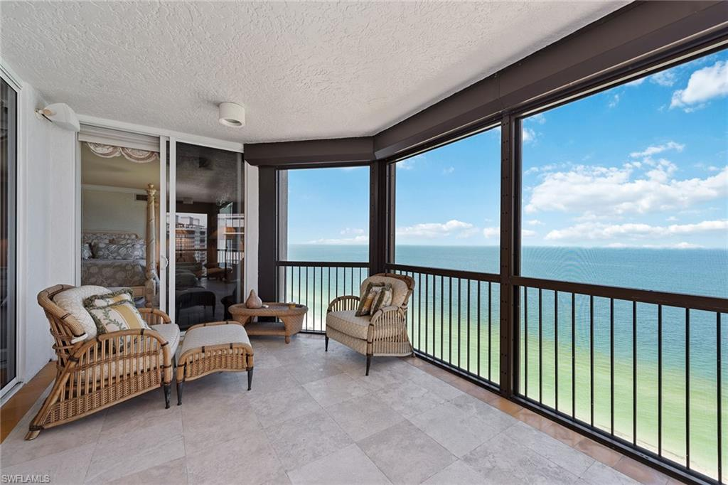 Gorgeous Gulf and beach views. Rarely available, higher-floor corner unit directly on the beach in the private gated community of Bay Colony in Pelican Bay. Featuring panoramic views of the Gulf of Mexico through floor-to-ceiling sliding glass, this highly sought-after floor plan welcomes you into an elegant entry foyer with a spacious living and separate dining area. Open kitchen and den offer plenty of room for entertaining family and guests, along with three full bedrooms, all with en-suite baths. The Biltmore amenities include a gorgeous, newer designer-renovated lobby with a 24-hour manned front desk, two guest suites, fitness center, social rooms and a resort-style pool. Bay Colony residents enjoy the use of their own private, newly renovated beach club and restaurant, a tennis club, as well as the use of the amenities of Pelican Bay. Private golf memberships are available separately.