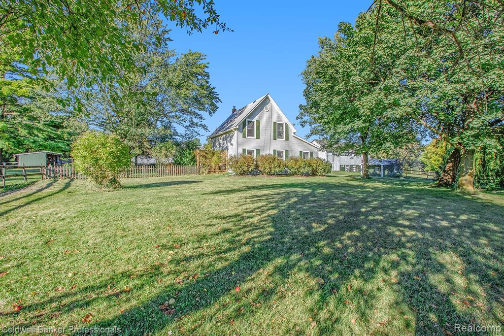 Just WOW!! This meticulously maintained 19th century home and property is sure to amaze you. Just over 12 acres of land, about half of it being wooded with walking trails, this property would make the ideal location to have a small farm, boutique horse ranch, a great get-away from the city, or a place to rest your head every night and call home. Land has multiple barns: 30x60 pole barn with power and horse stalls, a 32x64 horse barn with power and water, five house stalls, a hay room, an office, a feed room and a tack room, a 26x55 haybarn, as well as a cute milk shed. Horse fencing is in place and there is sand under the turf for arena ready for your horses to play. The 3 bedroom, 2 bathroom home has been tastefully decorated and maintained through time. Master bedroom and bathroom on the first floor, as well as the laundry room. New water softener, remodeled upstairs bathroom, the list goes on! Make this home your paradise and enjoy sunsets from the quaint deck out back. Call today!
