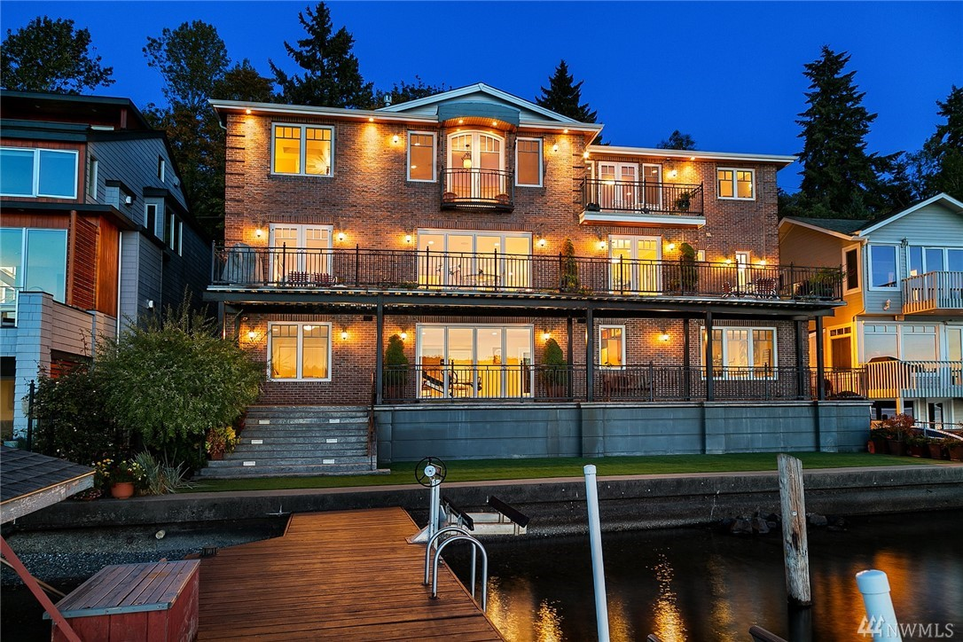 Magnificent west-facing 4BR/5.5BA, 6840SF waterfront estate w/views fr nearly every room. Gracious interior w/massive en-suite BRs, spa-like master, chef's kitchen, great rm, elevator, lakeside decks, lower level w/kitchen, rec rm, sound proof media rm & lots of storage. Quality construction, high-end fixtures & finishes, totally energy efficient hydrothermal heating & cooling systems. 70ft of frontage w/private dock, 2 boat & 1 jetski lifts. Close to VMAC & the rapidly developing SE Lk WA area!