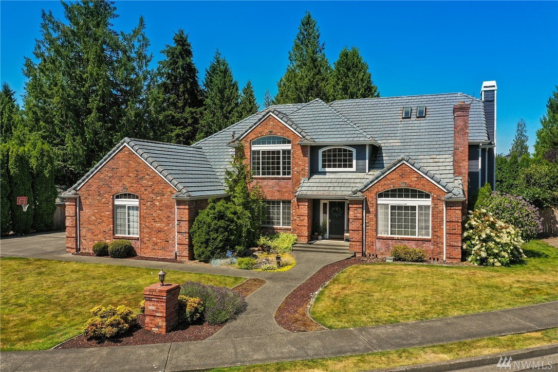 Exquisite home with Amazing Mt. Rainier view from your master suite! Curved wall entry & spacious den w/built-ins on main. Gorgeous Chef's Kitchen w/large island opens to family room. Extensively updated master retreat with true spa-like bathroom. Includes Bonus room & 3rd level loft area. Renovated laundry/mud room w/extra 1/2 bath. Timeless brick exterior & tile roof. Stylish landscaping, expansive trex deck & private yard to play & garden in. Huge corner lot, A/C, 3-car garage, Extra storage.