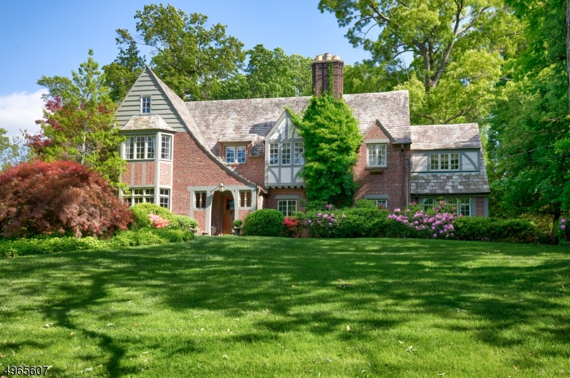 Architectural masterpiece located in prestigious North Side! This 5 Bed, 4 Full & 3 Half Bath storybook tudor renov & expanded top to bottom combining old world charm w/every modern convenience! Spectacular addition designed to integrate perfectly. Private, lush prop, outstanding outdoor spaces w/English Courtyard, stonework, ponds & cottage gardens. Outstanding addition w/Gour Chef's Kitc, Fam Rm, Side Entry/Mud Rm w/exquisite turret & rustic wood beams & Conservatory.  Livi Rm w/wood beamed ceiling & carved stone f/p. Din Rm w/strapwork ceiling & board/batten paneling. Elegant Library. Exquisite period details t/o. Secluded & spacious 2009 renov. MBR Suite w/cathedral ceiling & f/p. 4 additional spacious beds on same level. Huge LL renov. in 2019 w/Wine Rm, Rec Rm & Exercise Rm. Truly incredible home!