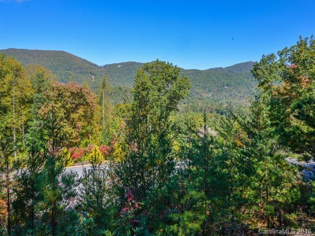 Incredible view from this fantastic lot in a small community in the Heart of Fairview. Only 5 minutes to Asheville, the Blue Ridge Parkway and the interstate. This lot is located at the end of the cul-de-sac and is perfect for a single family home. Access to the property is already in place which will save you time and money.  It's from the neighbors drive to the left if you're facing the lot.  Underground utilities including city water.