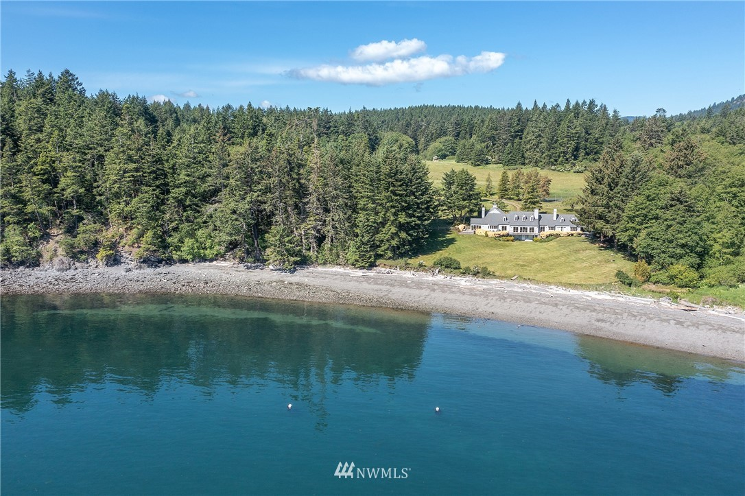 PASTORAL WATERFRONT WITH DYNAMIC VIEWS  Once-in-a-lifetime opportunity to own this magical 25+ acre Orcas Island legacy waterfront property boasting beautiful grounds, two mooring buoys, and sweeping views of Rosario Strait, the Cascades and Mt Baker. A private drive lures you through beautiful woods and open fields to your destination. A homeowner's dream with idyllic indoor and outdoor spaces. Spend your time gazing at the breathtaking views and diverse wildlife, or step down to the lush lawn gradually leading to 442' of low-bank waterfront. The property is complete with a 5000+ sq ft 4 bed/5 bath main home with 2-car garage, a 2296 sq ft 3 bed/2 bath renovated 1910 farmhouse, a 1222 sq ft 2 bed/2 bath cottage, and more.