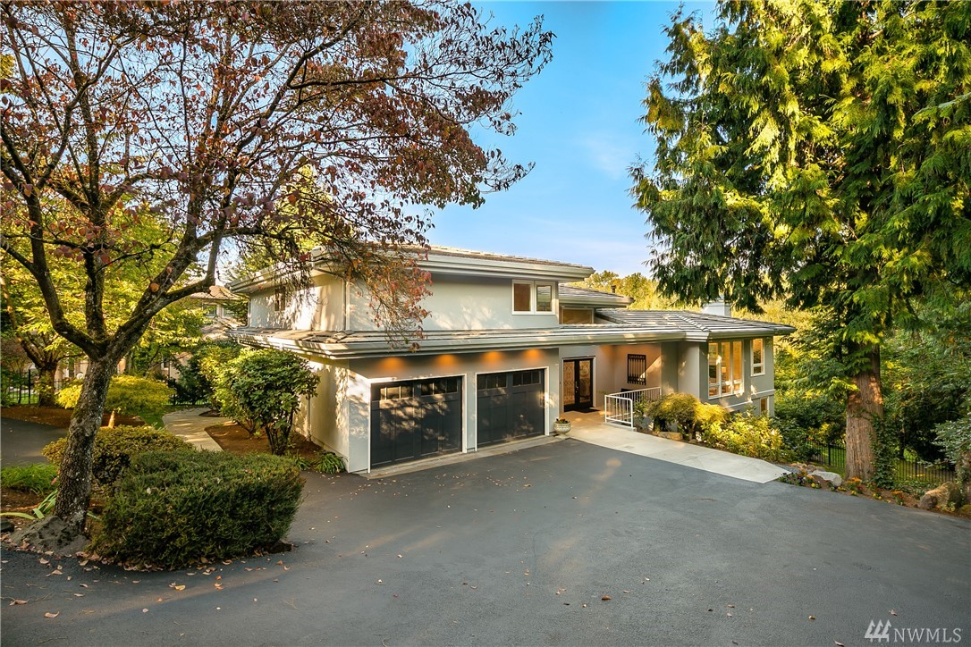 Masterfully remodeled classic/contemporary Hunts Point home on almost 1/2 acre. Enjoy a light filled open floor plan with large living spaces on the main floor and spacious kitchen with Wolf and Subzero appliances. French doors lead to the lake view/entertainment deck. Large master suite w/ flex room perfect for an office/exercise room. Downstairs with a 2nd master suite, entertainment room, wet bar and deck to the fully fenced back yard w/room for an outdoor living space, pool or tennis court.