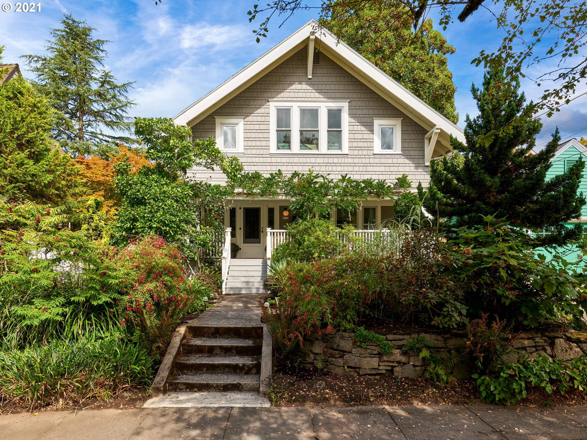 This 3 Bed, 1.5 Bath Craftsman Farmhouse in Grant Park is a dialed-in dream. Covered front porch, high ceilings over refin oak floors, built-ins, FP & vintage charm w/ fab accents of modernism. Exquisite kitchen remodel: SS appliances, quartz counters, Boos block island. DR w/ French doors to patio in fenced wraparound yard. 3 lg beds up w/ mega closets. Storage in basement & garden shed (w/elec & H2O). A/C. Hot locale by restaurants, MAX & Grant Park's pool, tennis, dog park. Mins to downtown! [Home Energy Score = 3. HES Report at https://rpt.greenbuildingregistry.com/hes/OR10194844]