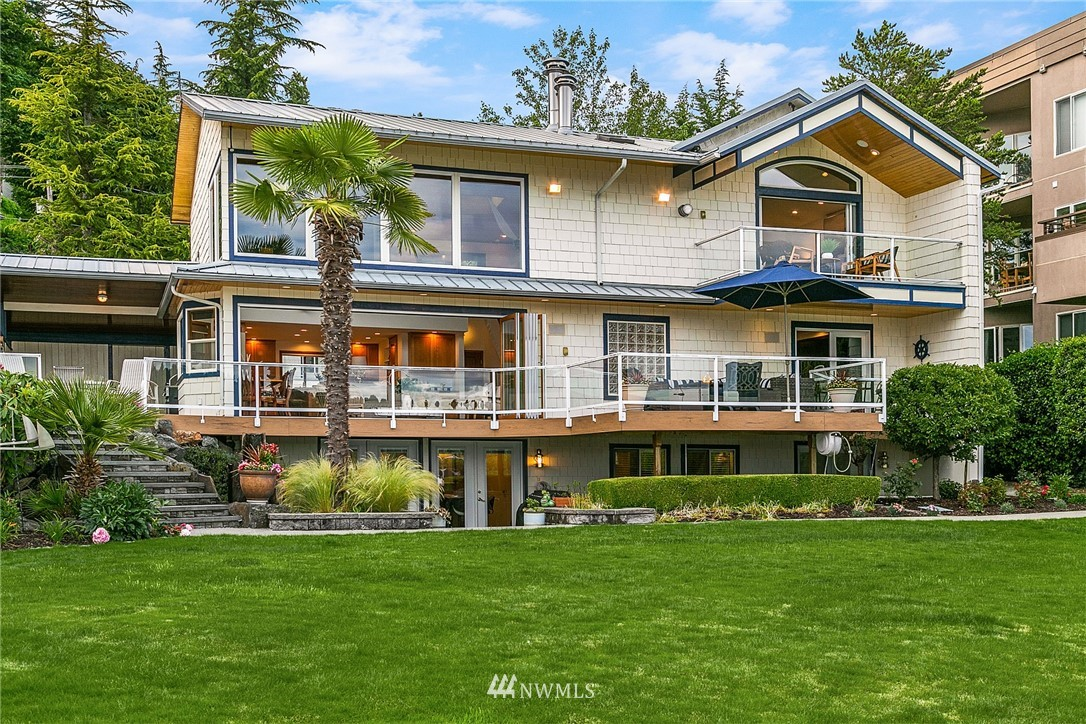One-of-kind waterfront! 78' of coveted south-facing Juanita Bay waterfront compound incls 5BR 4.75BA w/M-I-L apt & 2nd tax lot w/legal duplex & 8 car garage on 1/3 acre! Top 2 floors of light-filled home incl 3BR's (2 masters), loft office, 22' ceilings, teak & maple hdwds, spa-inspired master & 18' Panoramic to huge deck for seamless indoor/outdoor living & lwr level 2BR M-I-L apt. Legal duplex incls 2 1BR apts & 2 4car garages (8 cars total). 107' dock w/5 boat lifts & 2 jet ski lifts. A+ location 1 block to Juanita Bay Pk & Juanita Village, 5 mins to dwntwn Kirkland & I-405. Enjoy sweeping lake, Mt Rainier & city skyline views. Big level lawn to the water & significant parking -perfect venue for celebration of the waterfront way of life!
