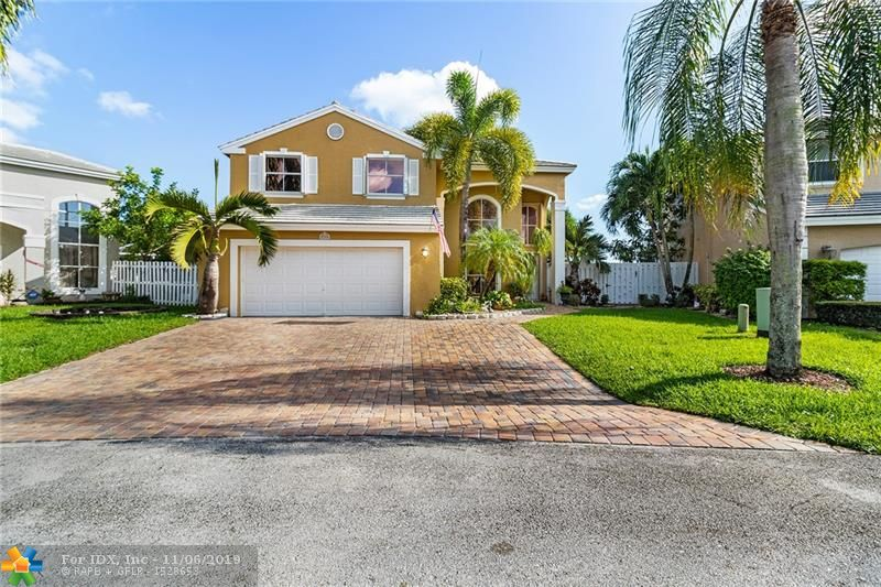 Fully updated  bright and spacious 3/2.5 single family home in a quite community in Coconut Creek. Breathtaking wide lake view from all the rooms down stairs and master bedroom upstairs. Home featured tile floors downstairs and wood floor upstairs. Only one guest room has carpet but wood materials is available for you to install. Updated kitchen with granite counter top, wood cabinet and stainless steel appliances. All the bathrooms are nicely renovated, new AC and water heater, roof is only 8 years old. Impact sliding door and some windows, accordion shutters on all windows, new blinds. Enjoy the beautiful lake view and wild lives from the screen patio every morning! You will love this home sweet home. Move in ready! Don't miss it! Call today to arrange your private tour!