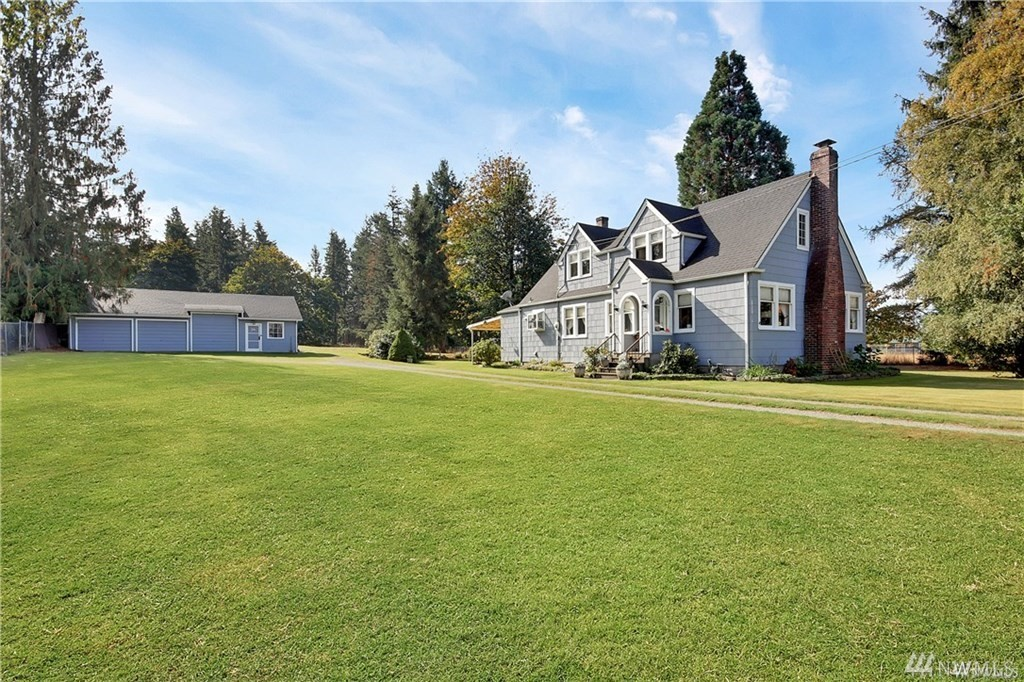 CHARMING FARMHOUSE on a shy 10 acres, close to town!  Enter thru the gate to your 4bd, 2bth home. Interior features NEW sliding barn doors, cozy living room w gas fireplace & large windows, master bedroom & baths on the main, dining room w/ built-ins, kitchen w/ breakfast nook. Fenced pastures, wooded areas, 3 car DETACHED GARAGE, BARN w concrete floor & hay storage, 25x50 metal RV storage & carport. NEW 5 BDRM SEPTIC, WINDOWS, FURNACE W A/C, COMPLETE UPPER LEVEL REMODEL W OFFICE & PELLET STOVE.