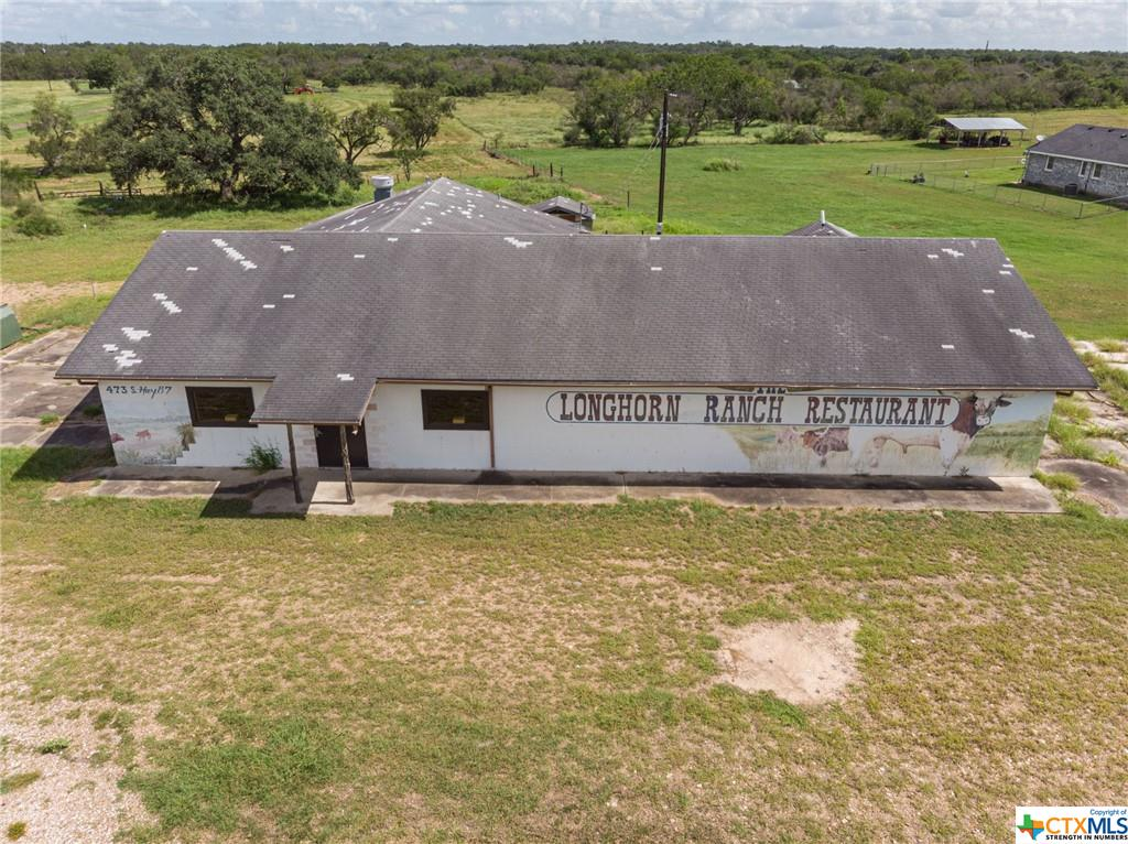 Great location with Highway 87 frontage. Busy Highway gives lots of visibility for any restaurant or business placed here. Inside is a large amount of open space ideally suited for a variety of businesses. Was the former Longhorn Restaurant. Plenty of parking. There is an aerobic septic system. Water well. This well-located property could be your next endeavor. Come check it out. Survey on file.